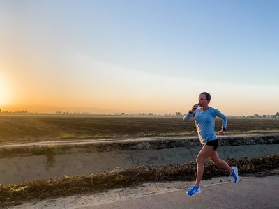 A runner takes in fuel during a training run. The next generation of wearable technology will change how athletes fuel for sport.