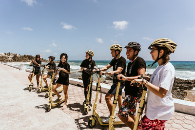 Selina guests in Isla Mujeres ride on Leo Electric Scooters